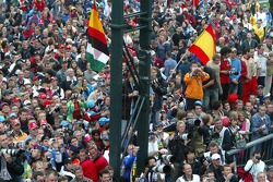 Fans wait for the podium ceremony