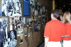Al Unser III examines photos in Jerry's Garage