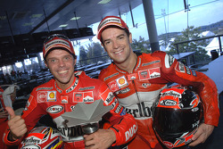 Race winner Loris Capirossi celebrates with Carlos Checa
