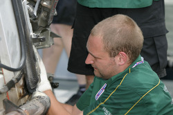 Aston Martin Racing crew member works on the wrecked #57 Aston Martin DB9