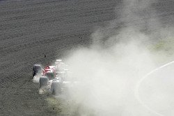 Start: Rubens Barrichello and Takuma Sato in the gravel