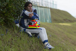 Antonio Pizzonia watches the race after his retirement
