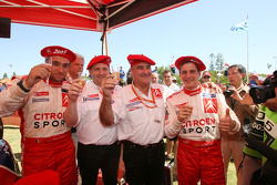 Rally winners François Duval and Sven Smeets celebrate with Guy Fréquelin