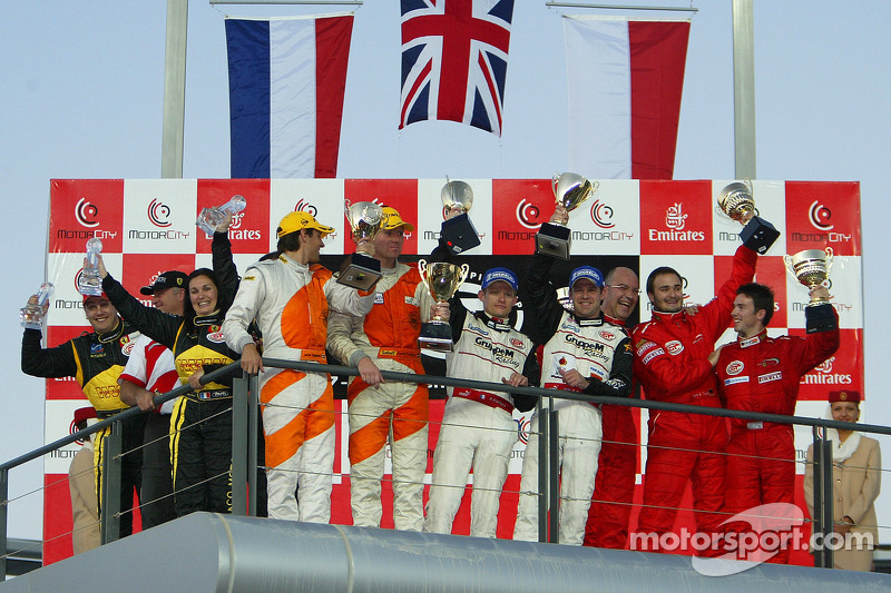 GT2 podium: class winners Emmanuel Collard and Tim Sugden, with Donny Crevels and Jeroen Bleekemolen, and Chris Buncombe, Albert von Thurn und Taxi and Lorenzo Case, and G3 winners Carine Sicart, Jonathan Sicart and Ange Barde