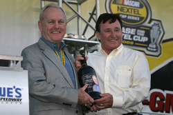 Humpy Wheeler accepts a special reserve wine from winemaker Richard Childress