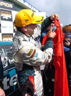 V8 Supercar 2005 champion Russell Ingall celebrates by shredding his bridesmaid tag