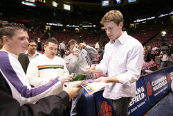 Carl Edwards signs autographs prior to the start of the game between the New Jersey Nets and the Detroit Pistons at the Continental Airlines Arena in East Rutherford, New Jersey