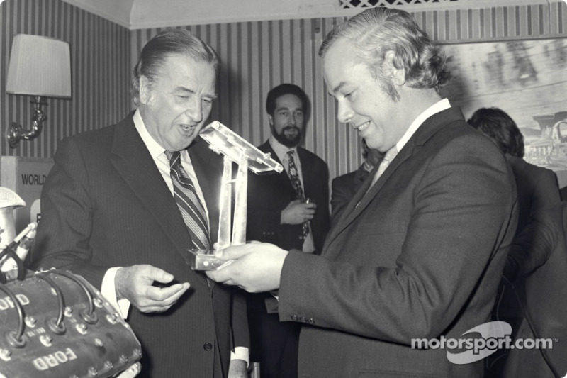 50th Grand Prix win: Henri Ford II presents Keith Duckworth with trophy for his 50 Grand Prix wins