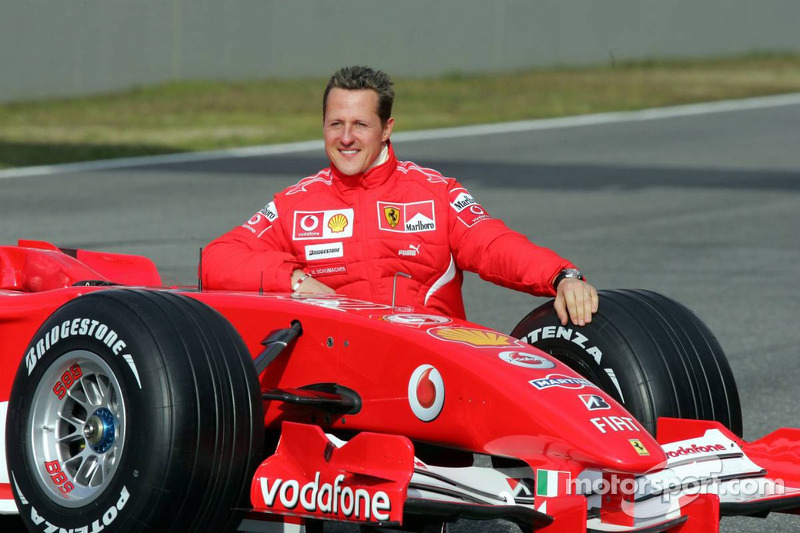 michael schumacher with the new ferrari 248 f1 at ferrari. Black Bedroom Furniture Sets. Home Design Ideas