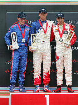 Podium: race winner Alexandre Premat with Robbie Kerr and Neel Jani