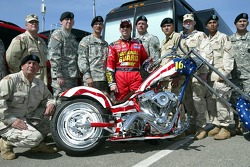 Greg Biffle poses with members of the National Guard and a custom-built Harley Davidson that will be auctioned off for the Greg Biffle Foundation