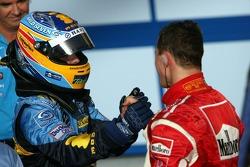 Race winner Fernando Alonso congratulated by Michael Schumacher