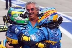 Race winner Giancarlo Fisichella celebrates with Fernando Alonso and Flavio Briatore