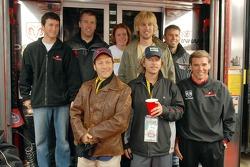 Kasey Kahne, Jeremy Mayfield, Rob Schneider, Erin Crocker, John Heder, David Spade, Scott Riggs and Ray Evernham pose for a photo