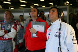 Midland F1 team members watch qualifying