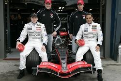 Kimi Raikkonen and Juan Pablo Montoya pose with football players Nathan Buckley and Alan Dodak