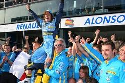 Race winner Fernando Alonso celebrates with his team