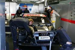 Audi mechanics work on the car of Martin Tomczyk