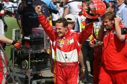Pole winner Michael Schumacher celebrates