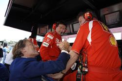 Luca di Montezemolo, Ross Brawn and Luca Baldisseri celebrate pole position