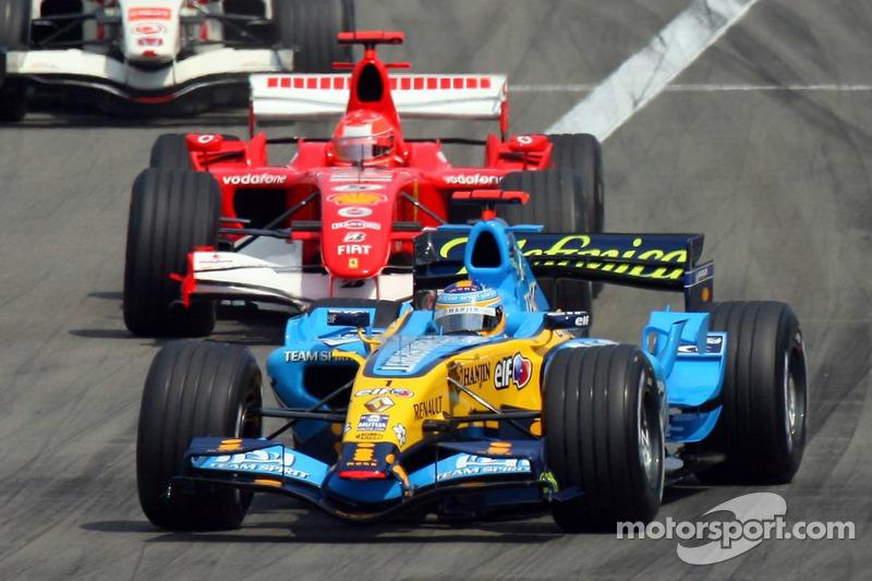 Restart: Fernando Alonso leads Michael Schumacher