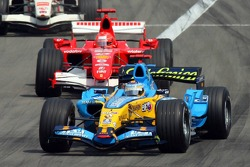 Restart: Fernando Alonso leads Michael Schumacher