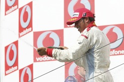 Lewis Hamilton race winner, sprays champagne