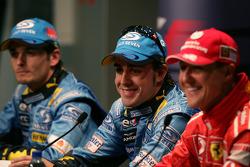 Press conference: pole winner Fernando Alonso with Giancarlo Fisichella and Michael Schumacher