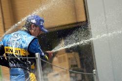 Podium: champagne for Fernando Alonso