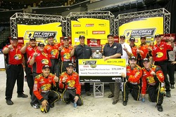 The pit crew of the #1 Bass Pro Shops Chevrolet, driven by Martin Truex Jr., celebrates winning the NASCAR Nextel Pit Crew Challenge