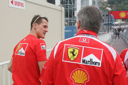 Michael Schumacher and Ross Brawn leave the stewards building after a meeting