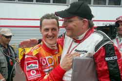 Michael Schumacher celebrates with Kees van de Grint, Bridgestone tire engineer