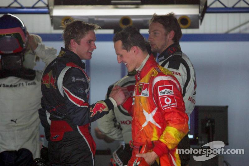 Scott Speed, Michael Schumacher y Jenson Button