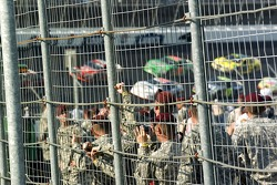 Troops watch the start of the race
