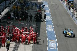 Giancarlo Fisichella leaves pitlane as Felipe Massa makes a pitstop