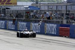 Lewis Hamilton takes the checkered flag to win the race
