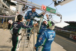 Pescarolo Sport team members work on the refuel system