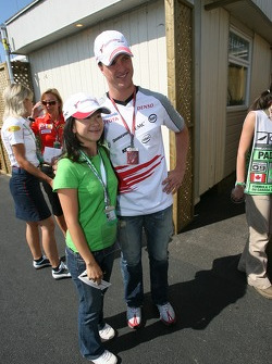 Ralf Schumacher poses with a fan