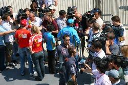 Michael Schumacher, Fernando Alonso and Tiago Monteiro