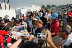 Nico Rosberg signs lots of autographs for fans