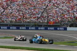 Fernando Alonso leads Rubens Barrichello