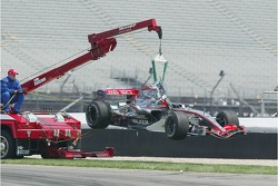 Car of Kimi Raikkonen is taken away after the crash at turn 1