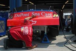 A crew member checks the back end of Jeff Gordon's car