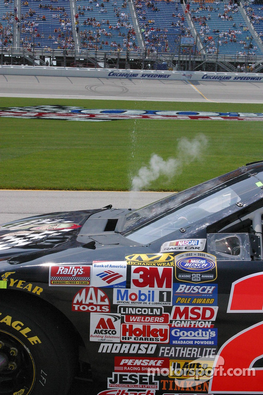 Water pours from the overflow on Carl Long's car
