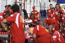 Michael Schumacher watches Ferrari pitstop practice