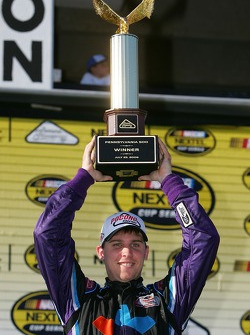 Victory lane: race winner Denny Hamlin celebrates