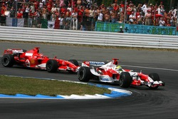 Michael Schumacher while leading the race allows his brother Ralf Schumacher to unlap himself