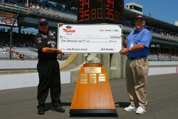 Gil Martin, crew chief for the #07 Jack Daniels Chevrolet, is awarded with the