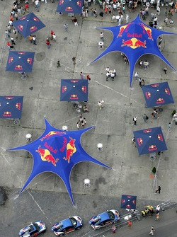 Running bulls rendez-vous in Budapest: Red Bull umbrellas and cars