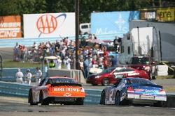 Kurt Busch and Tony Stewart battle for the lead